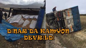 DİNAR'DA KAMYON DEVRİLDİ