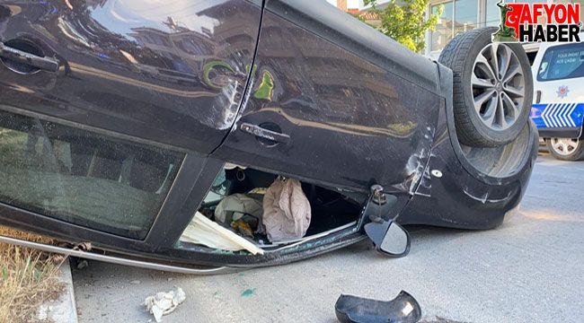 Afyon'da kontrolden çıkan otomobil takla attı