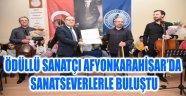 ÖDÜLLÜ SANATÇI AFYONKARAHİSAR'DA SANATSEVERLERLE BULUŞTU